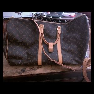 LOUIS VUITTON DUFFLE BAG LIGHTLY WORN ** A+